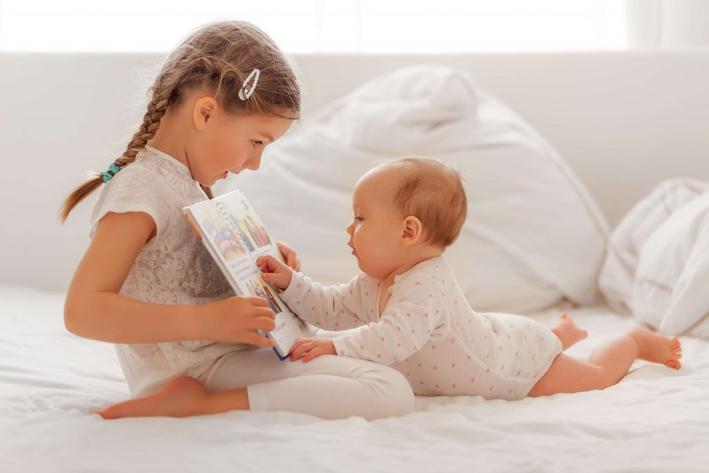 The older child may become a great mentor and role model for the younger one from an early age.