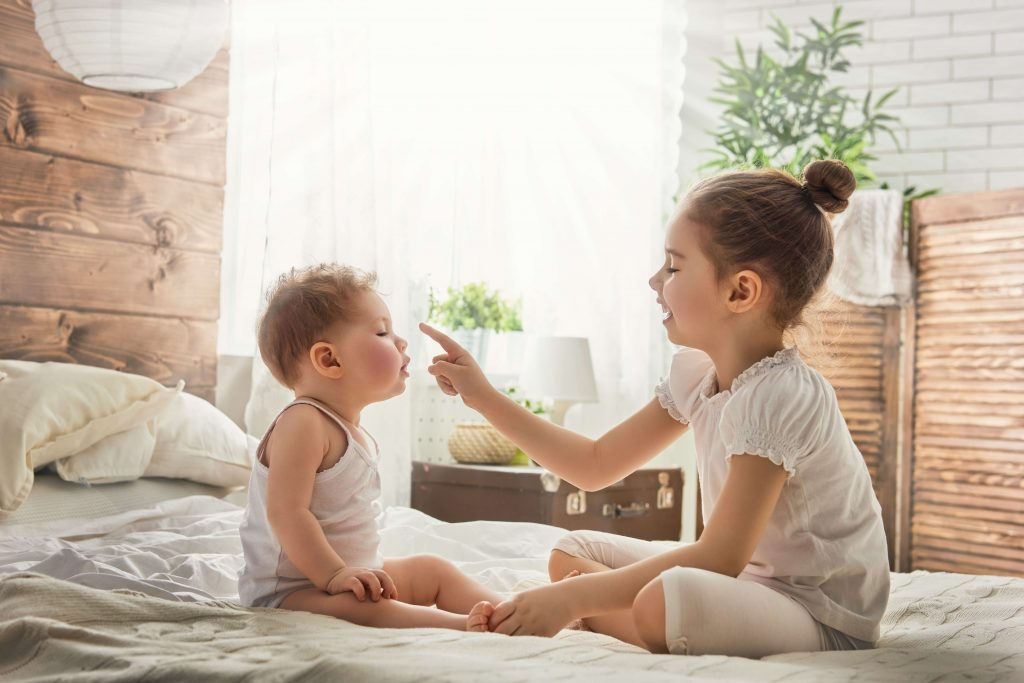 Siblings often balance each other's similarities and differences while playing together.