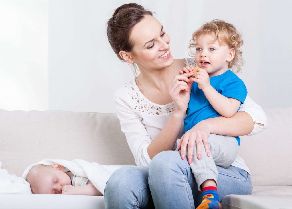 A mother spends an equal amount of time with both her children.