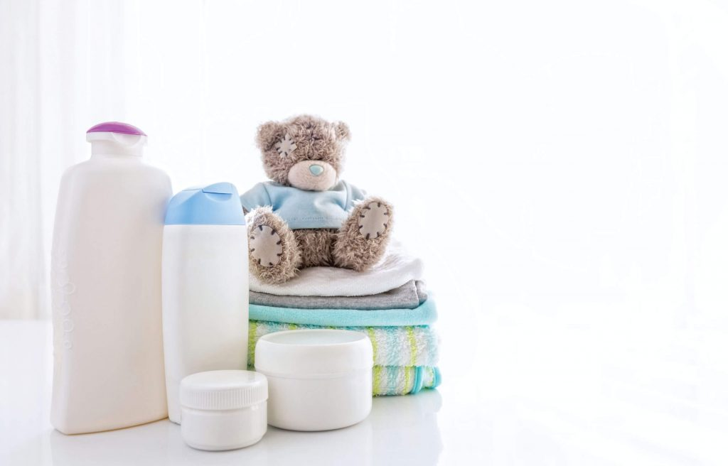 mild skin products for your baby and dress them only in washed clothes