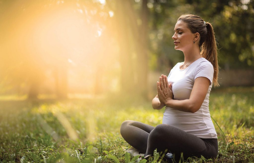 Meditation is a great stress buster to prevent hair fall in pregnancy.