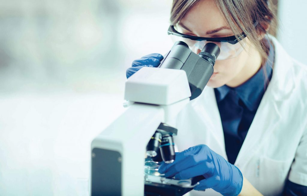 Researcher studying neuronal cell development in mice