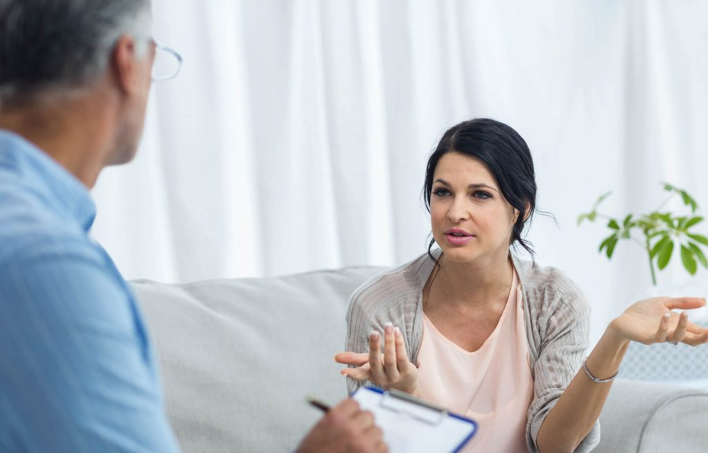 Woman talking to the doctor about dealing with an unplanned pregnancy