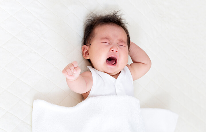 Baby showing signs of discomfort due to incomplete baby care in winter season